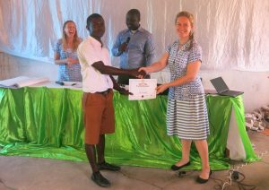 Presentation of certificates at training event in Ghana