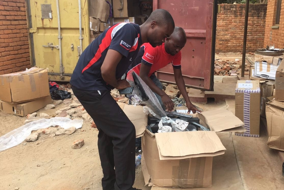 Unpacking the container in Mzuzu, Malawi
