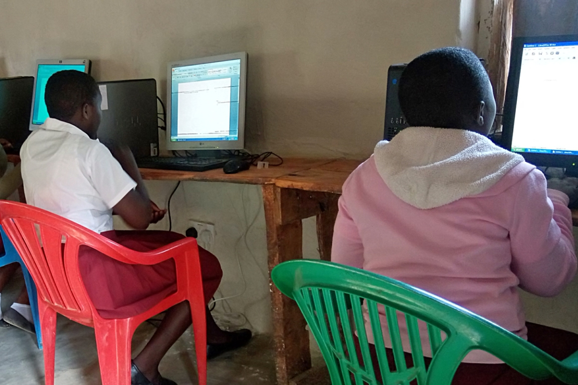 Girls learning IT at Chinunkha Community Day Secondary School