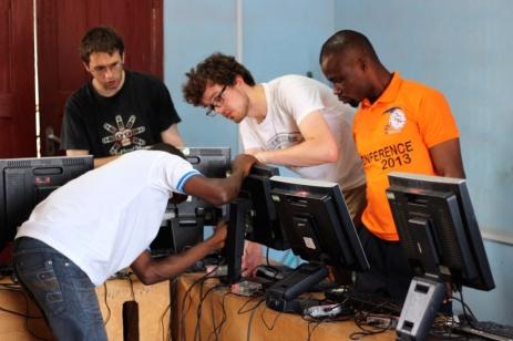 Volunteers help setting up computer lab