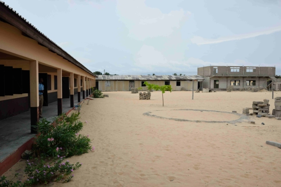 Kedzi ICCES - on a beach with construction of a hostel in progress