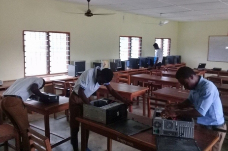Students at Tetrefu ICCES maintaining computers