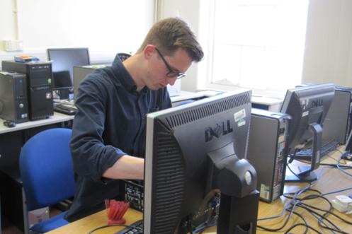 Volunteer wiping computers Edinburgh