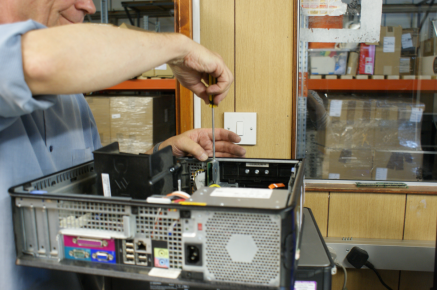 Volunteer refurbishing a PC