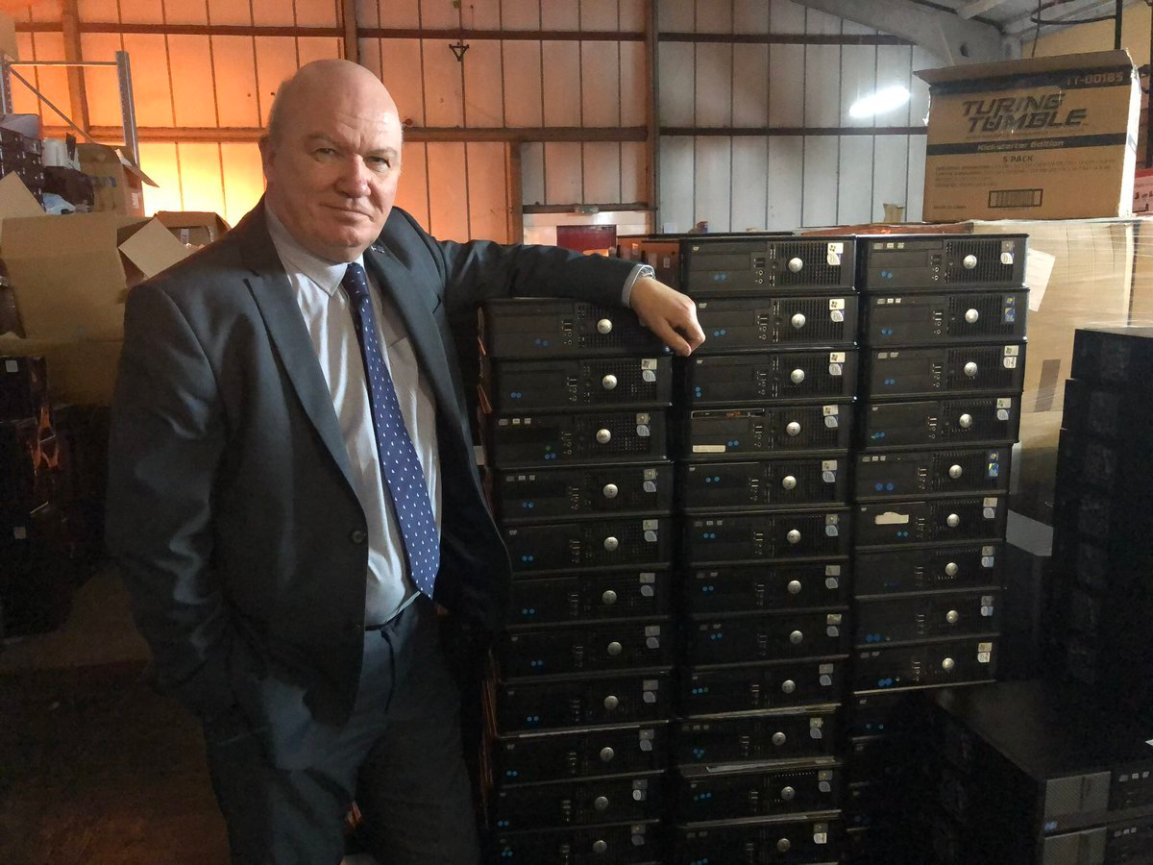 Gordon MacDonald pictured with PCs ready for Malawi in the Turing Trust workshop