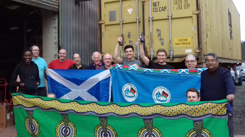 The team celebrate filling the container for Malawi