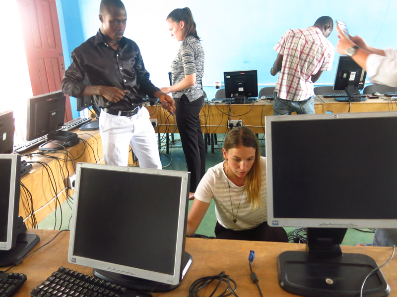 Volunteers setting up a computer lab at Dodowa ICCES, Ghana