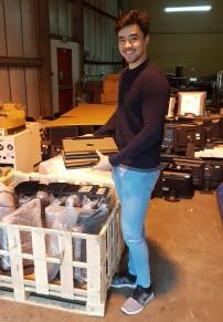 Volunteer unpacking new donations