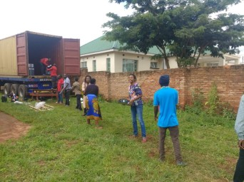 A human chain makes light work of unloading the container