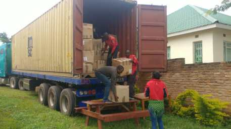 Unloading boxes of monitors from the container